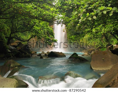 Celestial blue waterfall in Costa Rica - stock photo