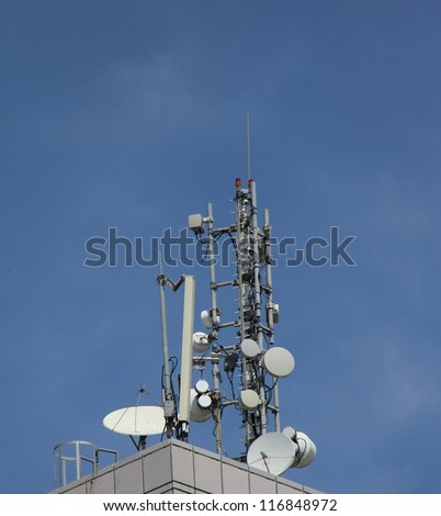 Cell antennas installed on the roof - stock photo