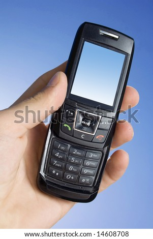 Cell phone against the blue sky - stock photo