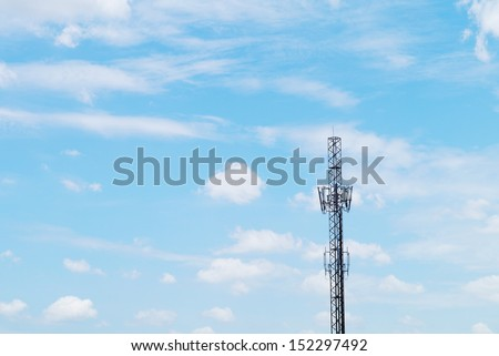 Cell phone and communication towers blue sky background.