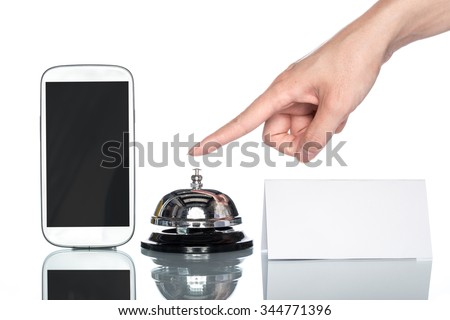 cell phone and Service bell with human hand on white background