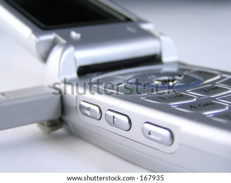cell phone connected to a computer via usb isolated on white.