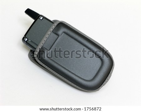 Cell phone in a padded case over white
