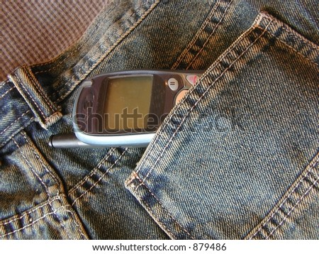 cell phone in back pocket of jeans - stock photo