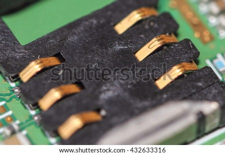 Cell phone mother board gilded contacts  - stock photo