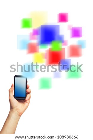 Cell phone (smartphone with touchscreen) in male hand and a futuristic digital depiction of social media over white background - stock photo