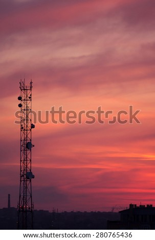Cell tower on a background of red sunset