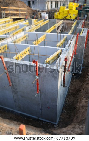 Cellar construction Construction site with the unfinished cellar part - stock photo