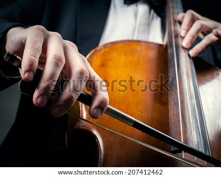 cellist hands close up - stock photo