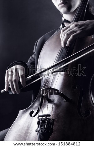 Cellist playing classical music on cello. Black-and-white photo - stock photo