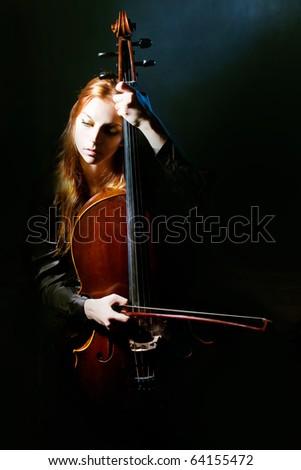 cello musician, Mystical music - stock photo