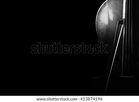 Cello on a black background. Stringed instrument - stock photo