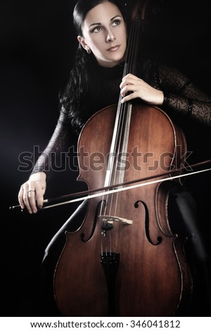 Cello player cellist playing music instrument Classical orchestra musician