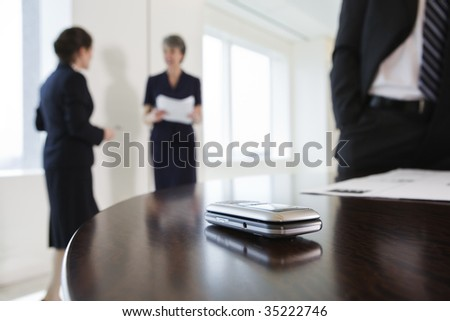 Cellphone on table - stock photo