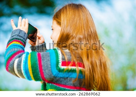 Cellphone Pictures Taking. Girl with Smartphone Taking Pictures. - stock photo