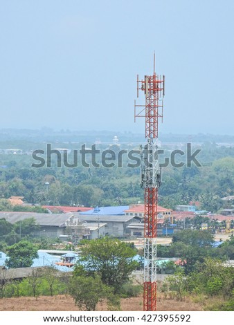 Cellular antenna with blue sky - stock photo