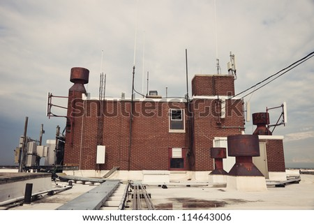 Cellular antennas installed on the top of the roof penthouse. - stock photo