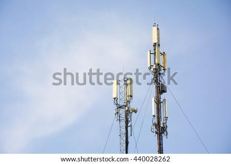Cellular gsm antennas on the blue sky - stock photo