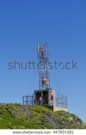 Cellular, microwave and telecom communications antennas in the top of the mountains - stock photo