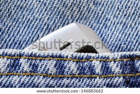 Cellular phone in the jeans pocket concept of communication and style - stock photo