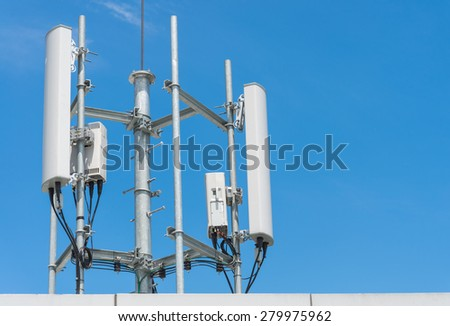 Cellular tower in the blue sky - stock photo