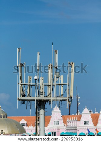 Cellular tower with communicaitons equipment - stock photo
