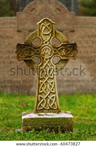 Celtic cross at a gravesite in an old cemetery - stock photo
