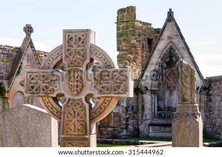 celtic cross on a graveyard at st. andrews, scotland - stock photo
