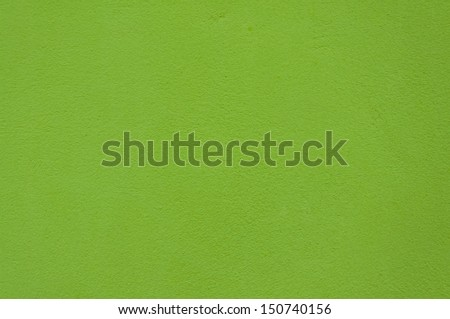 Cement background with a texture of green wall. - stock photo