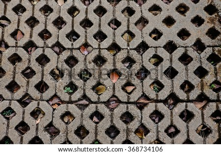 Cement brick floor with a hole background - stock photo
