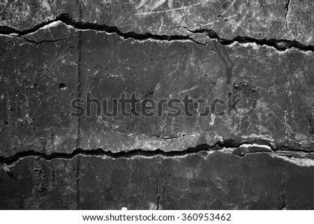 Cement cracked black - stock photo