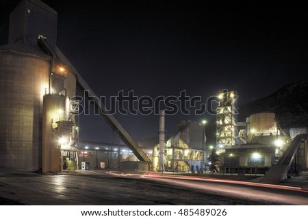 Cement factory at night detail view.