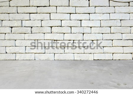 cement floor over white brick wall background ,can be used for display or montage your products