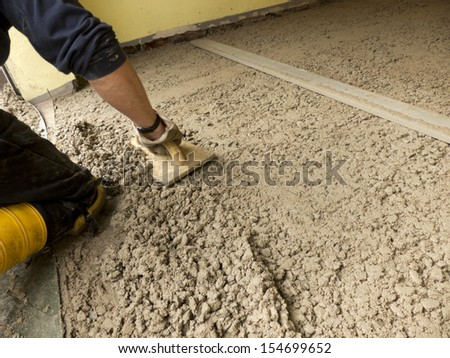 Cement is smoothed with a trowel   - stock photo