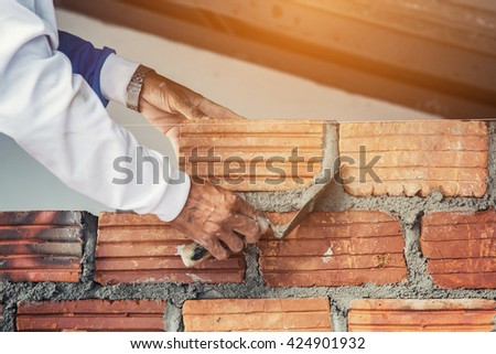 Cement masons and plasterer, brick for building - stock photo