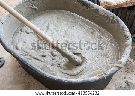 cement mix concrete is compacted sand by spade for construction - stock photo
