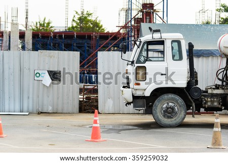 Cement mixer truck at a construction site, selective focus at the truck - stock photo