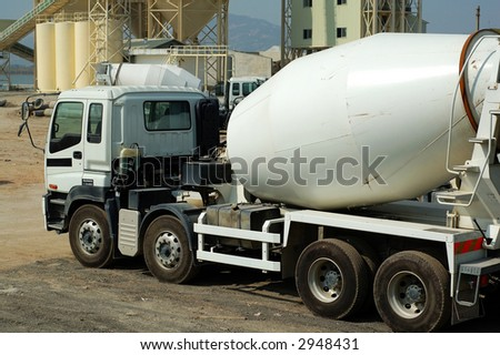 Cement mixer trucks in the plant - stock photo