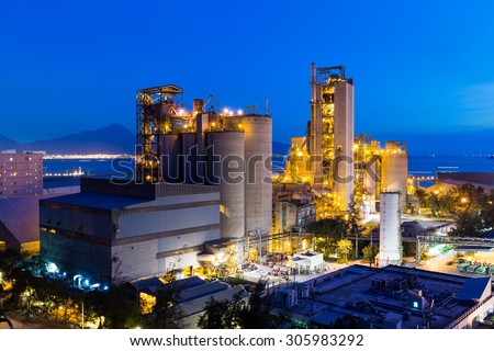 Cement Plant and power complex at evening - stock photo
