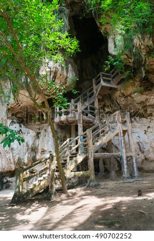 Cement staircase, leading up to Khao Khanap Nam Cave in Krabi, Thailand, designed to look like ancient, rotting wood.