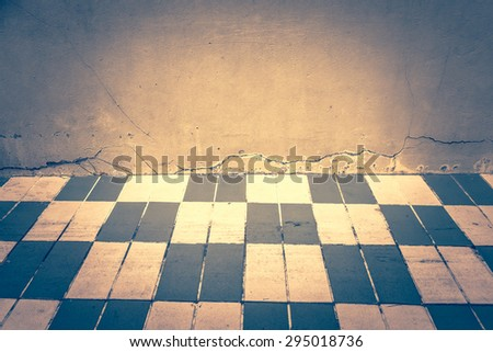 cement wall and designed brick floor - stock photo