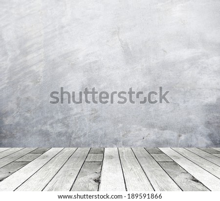 Cement wall and vintage wooden floor, perspective view.