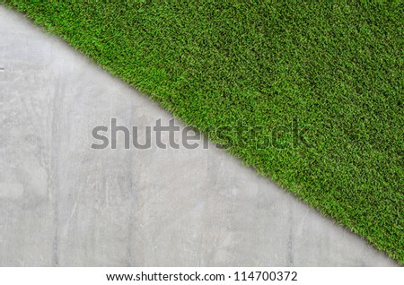 cement wall with artificial grass background