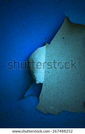 Cement wall with peeling paint