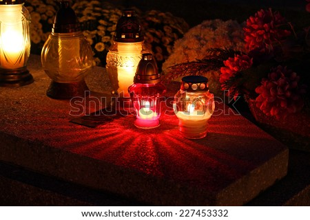 Cemetary decorated with candles for All Saints Day at night  - stock photo