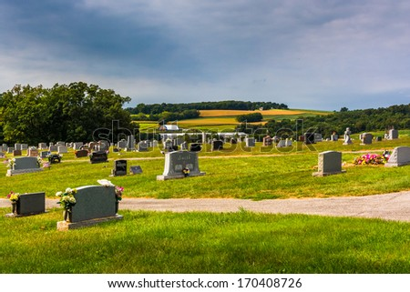 Cemetery and view of rolling hills in York County, Pennsylvania. - stock photo