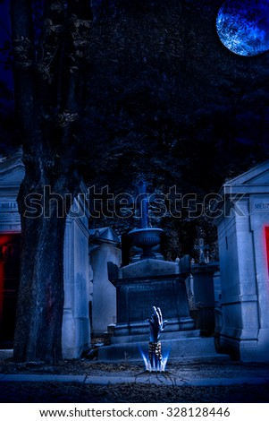 Cemetery Halloween background with graves and zombie hand  - stock photo