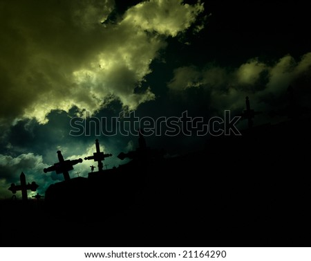 cemetery with dark clouds and crosses - stock photo