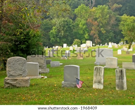 Cemetery with many gravestones right before Halloween.