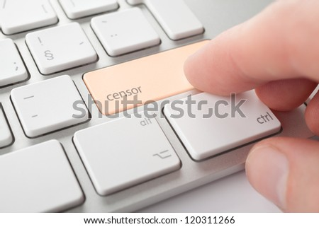 Censor press keypad on his keyboard. Internet censorship (expurgate, monitoring and control) threat concept. - stock photo